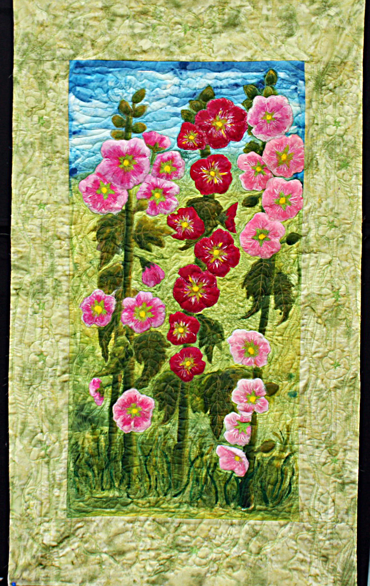 QAn art quilt featureing two Hollyhocks