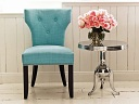 Notice the statement created by this  blue chair in a neutral setting