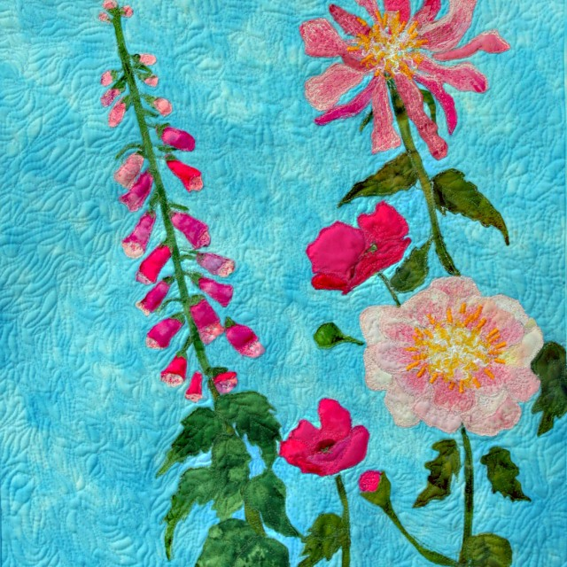 A floral art quilt with cottage flowers.