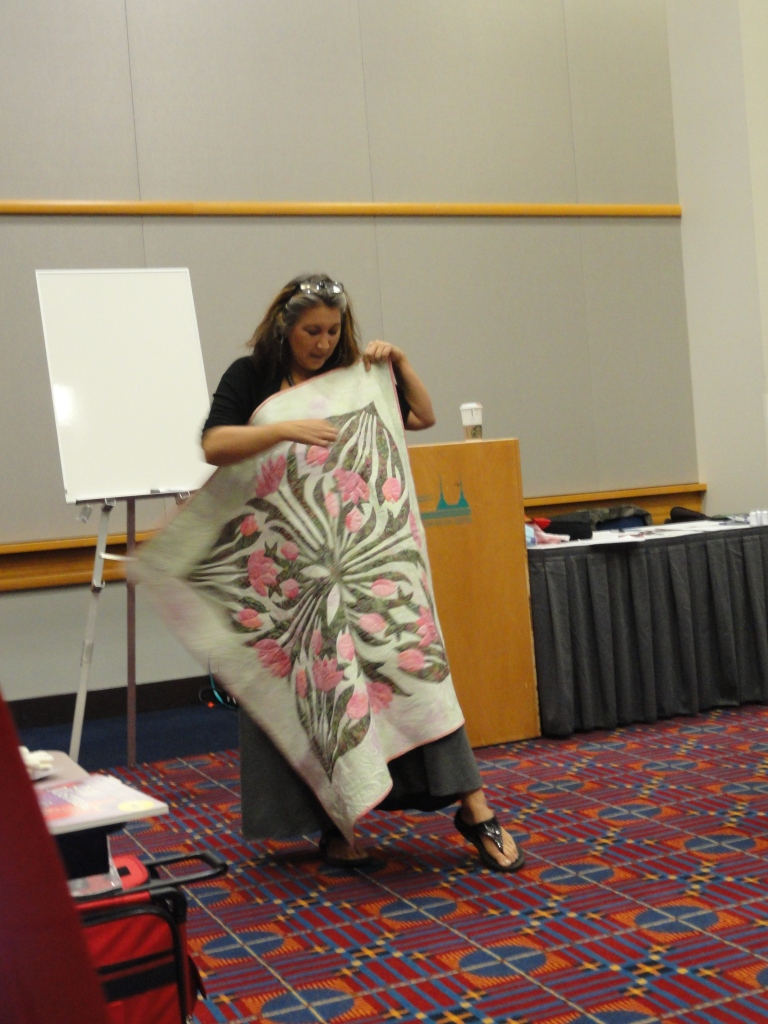 Karen McTavish showing her quilt.
