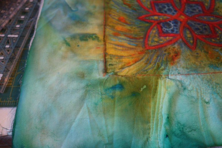Fire and Ice art quilt. Hand painted silk art quilt with lively thread play.