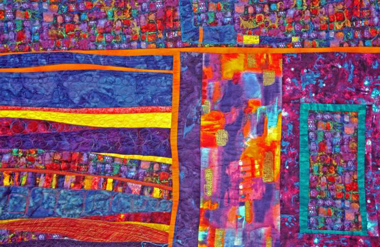 A bright art quilt in neon colors