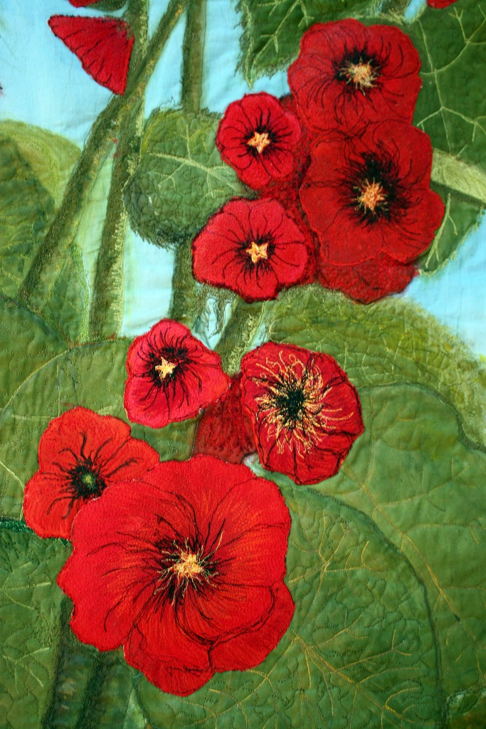Red hollyhocks art quilt detail of one stock