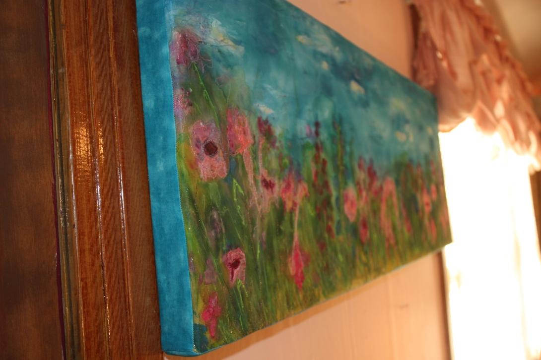 Color Melts a silk painted fiber art quilt.