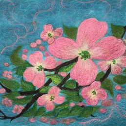 A silk painted fiber art quilt, blue skys and pink dogwoods