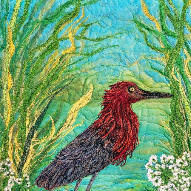 Red Egret an art quilt by Barbara Harms.